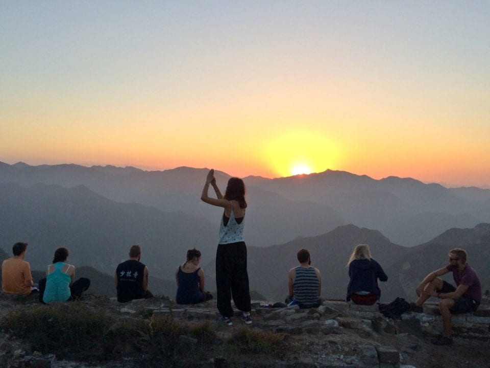 Watching the sunrise from the Great Wall of China on a China group tour