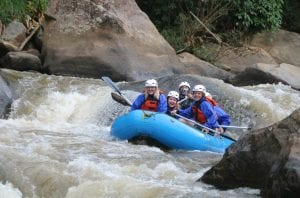 Backpacking tour group goes white water rafting in Chiang Mai