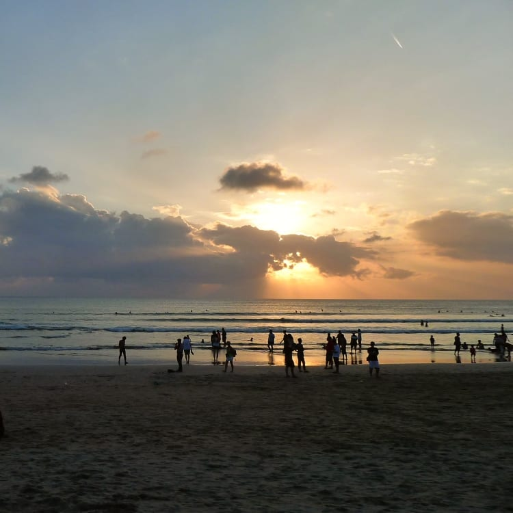 Backpacking group stand on beach in Bali